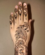 2013 simple party mehndi design on back hand 150x180 Fancy Hand Mehndi Designs For Women